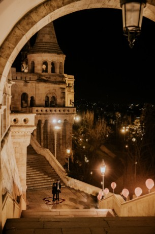 Location: Budapest, Hungary Date: February 20, 2020 Venue: Fisherman's Bastion  Photographer: Daniel  Documenting a proposal is challenging enough even on a summer afternoon, so I was very excited to do this tonight! Yuval had no idea she would be engaged by the time she walks all the way down the steps. Although, with a little help from Yossi's friends, the place certainly looked like a proposal was about to happen...