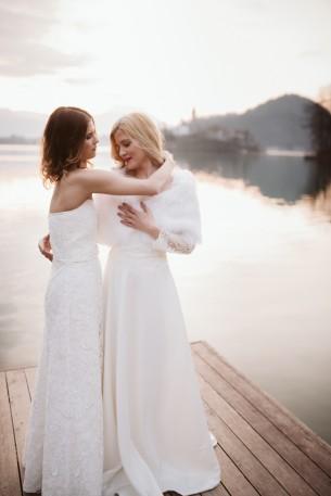 Location: Lake Bled, Slovenia Date: April 8, 2018  MUA: Erzsebet Harskuti Dress: Azenruham Bouquets: Art Flora Viragbolt  Photographers: Daniel